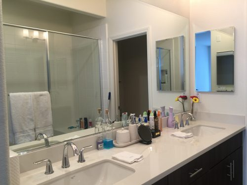 Photo of cleaned bathroom with dual sinks